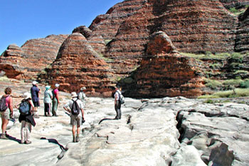 Fly to the Bungle Bungles then hike to the domes